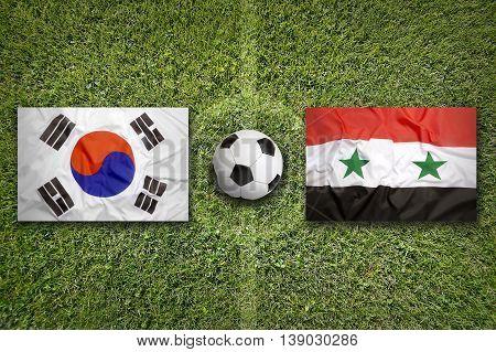 South Korea Vs. Syria Flags On Soccer Field, 3D Illustration