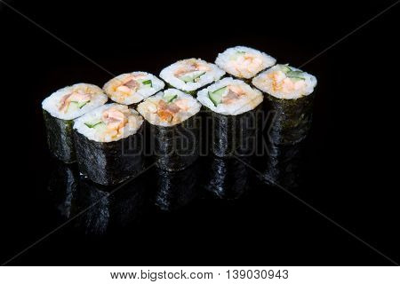 Traditional japanese rolls isolated on a black background