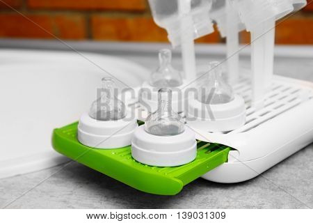 Baby bottles on plastic drying rack