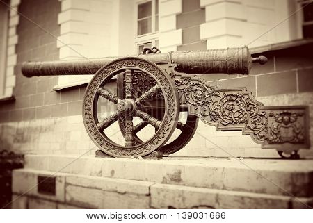 Old cannon in Moscow Kremlin. UNESCO World Heritage Site. Vintage style sepia photo.