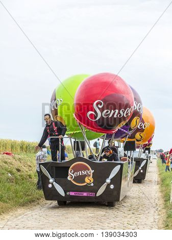 Quievy, France - July 07 2015: Senseo Caravan during the passing of the Publicity Caravan on a cobblestone road in the stage 4 of Le Tour de France on July 7 2015 in Quievy France. Senseo is a registered trademark for a coffee brewing system.
