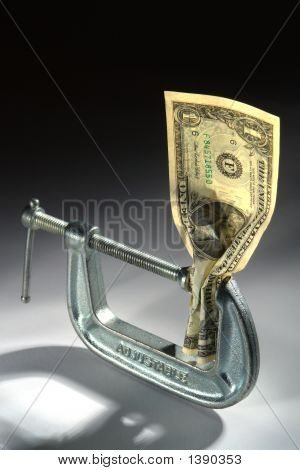 Cash Squeeze Dollar Bill Money in Tight Vise Clamp