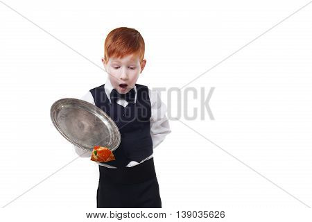 Clumsy little waiter drops tray serving piece of pizza, food falling down. Redhead child boy in suit shows inattentive waiter failure at white background