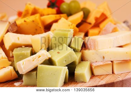 Cut french cheese blocks background close up