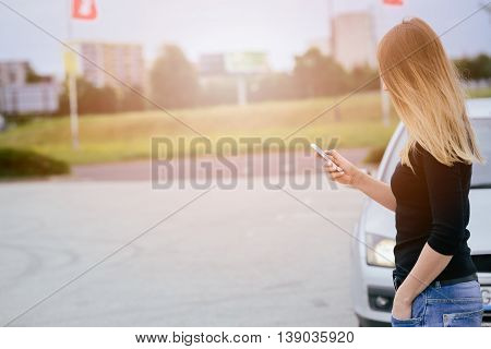 Woman With Phone Playing The Mobile Games