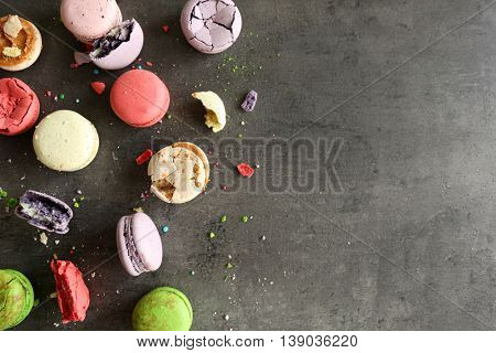 Different colorful macaroons on gray background