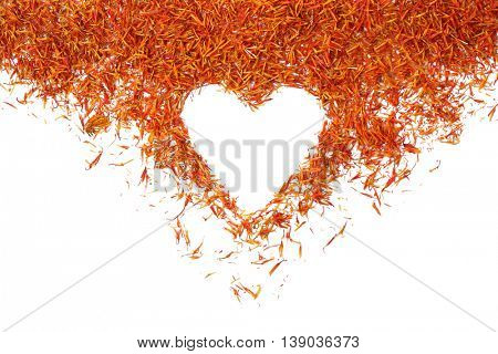 Saffron with heart silhouette on light background