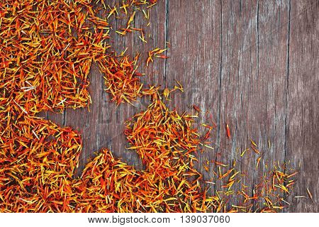 Saffron with star silhouette on wooden background
