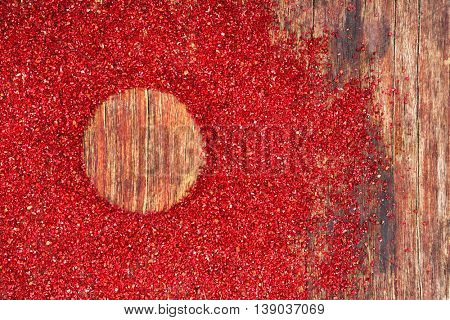 Dried sumac with round silhouette on wooden background