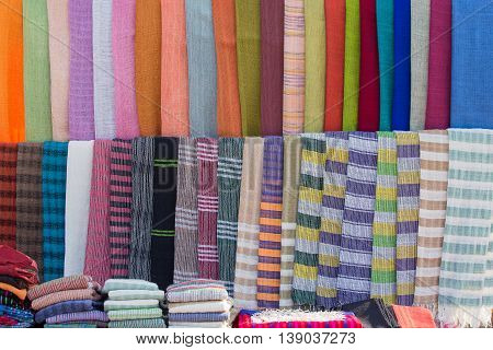 Colorful scarves at a fabric market on the Inle lake in Myanmar Burma . Close up
