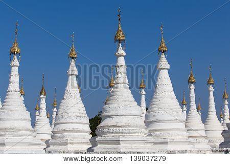 Sanda Muni white pagoda at blue sky background in Mandalay Myanmar Burma