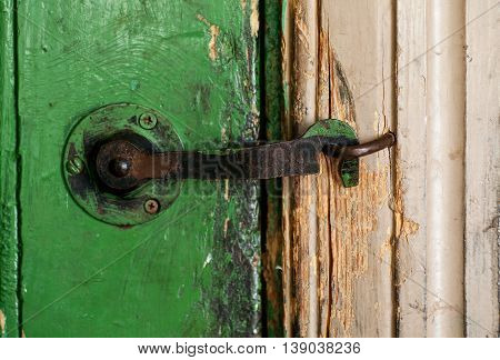 Old rusty metal door hook clodeup shot