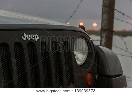 Leningrad region, Russia , July 12, 2016 , Jeep Wrangler on the first North Fort in Kronstadt, the Jeep Wrangler is a compact four wheel drive off road and sport utility vehicle