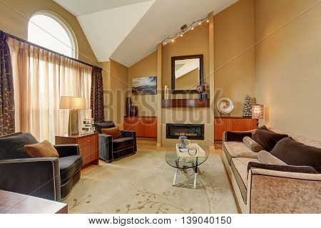 Beautiful Brown And Beige Living Room With Vaulted Ceiling.