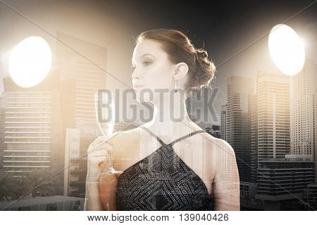 holidays, nightlife, drinks, people and luxury concept - beautiful young asian woman drinking champagne at party over dubai city with double exposure background