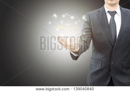 Businessman showing Key to success in successful concept