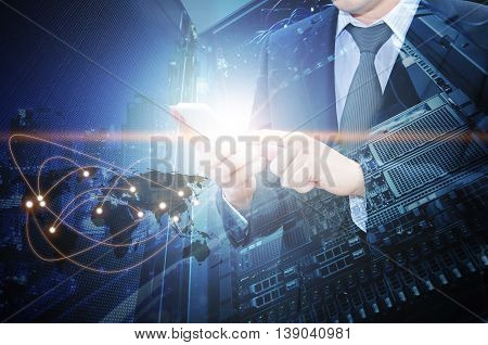 Double Exposure Of Professional Businessman Using Smart Phone With Servers Technology In Data Center