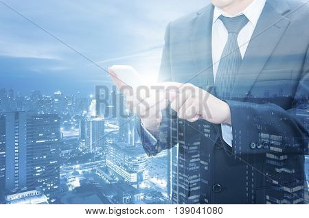 Double Exposure Of Businessman Touching With Smart Phone World Business Network Connection And City