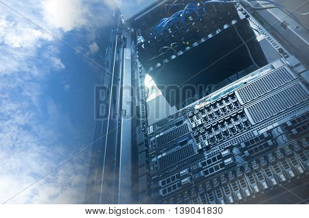 Cloud And Sky Overlay With Servers Computing Technology In Datacenter Creative Cloud Concept