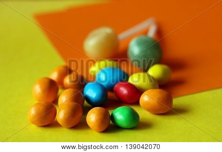 colorful chocolate coated candy. Orange and yellow. Autumn theme.