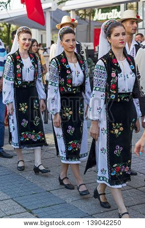 ROMANIA TIMISOARA - JULY 7 2016: Young Romanian dancers in traditional costume present at the international folk festival