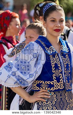 ROMANIA TIMISOARA - JULY 7 2016: Young Romanian dancer in traditional costume present at the international folk festival