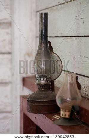 Vintage kerosene lamp and candle holder vertical