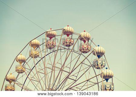 ferris wheel against blue sky vintage filter effects