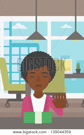 An african-american young business woman sitting at the table in office and moving dollar bills away. Vector flat design illustration. Vertical layout.