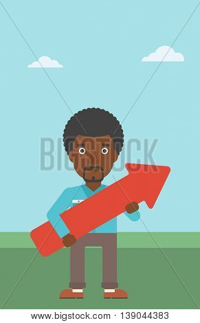 An african-american young businessman holding a big arrow in hands. Successful business concept. Vector flat design illustration. Vertical layout.
