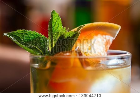 Drink with slice of grapefruit. Ice and mint. Cool beverage that tastes great. Save yourself from the heat.