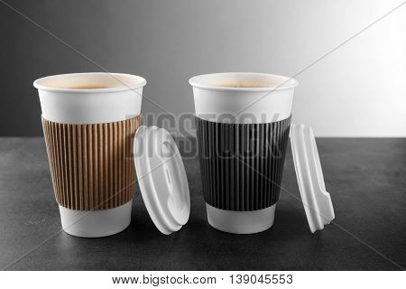 Coffee-to-go. Paper cups of coffee on the table