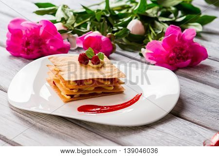 Dessert with red berries. Mint and custard. Sweet sauce for traditional millefeuille. Pastry from french cuisine.