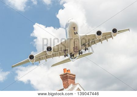 FARNBOROUGH, UK - JULY 14: Airbus A380 on a low-level banked approach before landing at an aviation trade event in Farnborough, UK on July 14, 2016