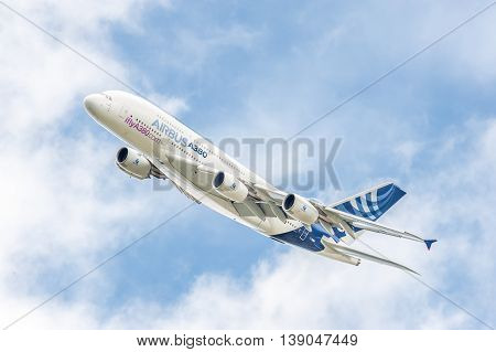 FARNBOROUGH, UK - JULY 16: Airbus A380 on a low-level banked turn prior to landing at an aviation trade event at Farnborough, UK on July 16, 2016