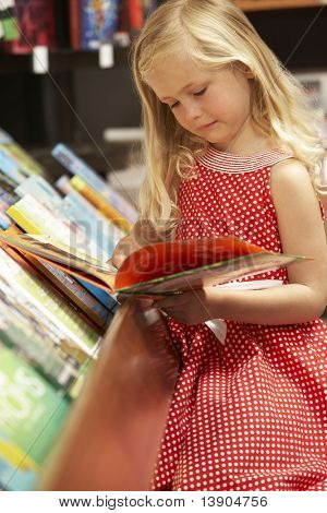 Young girl in bookshop