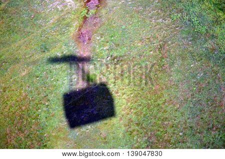 shadow cable car in a green meadow