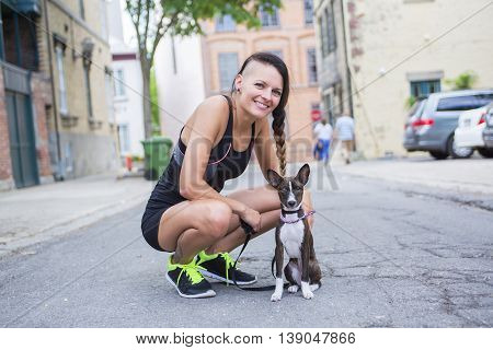 A woman portait with dog in city street