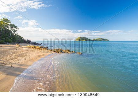 The famous idyllic beachfront of Palm Cove on a winter's day in Queensland, Australia