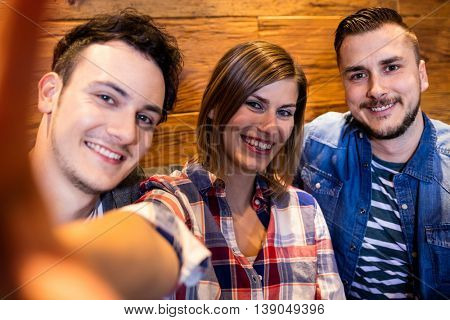 Portrait of smiling friends at restaurant