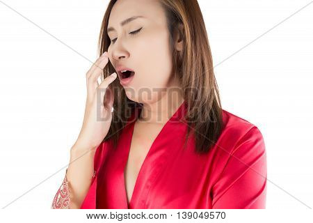 Asia woman yawns of boredom on white background