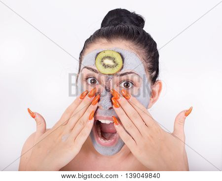 Woman With Facial Mask And Kiwi Slice