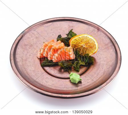 Salmon Sashimi With Lemon And Wasabi On A Clay Plate Isolated On White Background