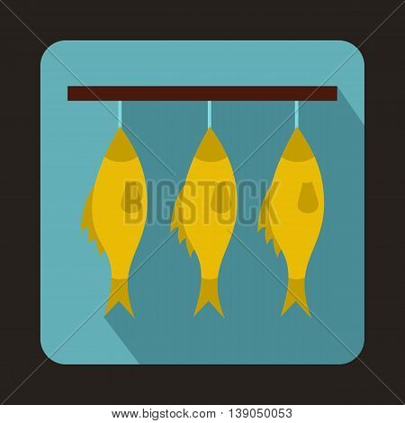 Three dried fish hanging on a rope icon in flat style on a baby blue background