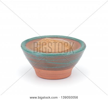 Nut Sauce In A Clay Sauce-boat Isolated On White Background