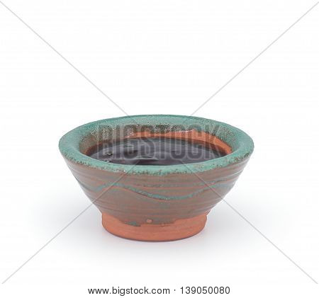 Unagi Sauce In A Clay Sauce-boat Isolated On White Background