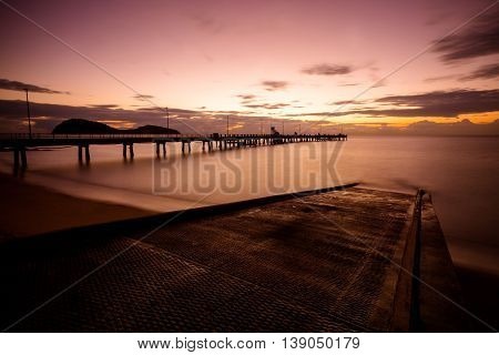 The iconic Palm Cove jetty and boat ramp at sunrise on a winter's morning in Queensland, Australia