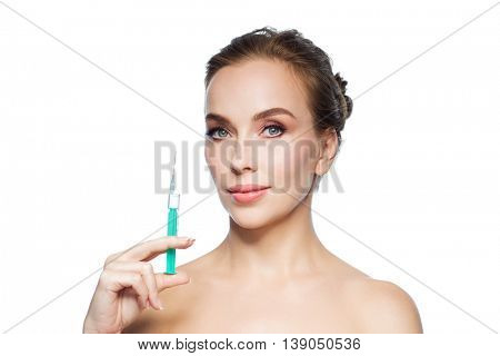 health, people, cosmetology, plastic surgery and beauty concept - beautiful young woman holding syringe with injection over white background
