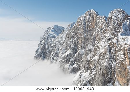 Dachstein Mountains in beautiful weather above the fog - austria