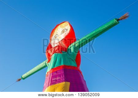 russian traditional carnival doll. Portrait of Shrovetide doll on background blue sky. Pancake week. Russian carnival. Maslenitsa
